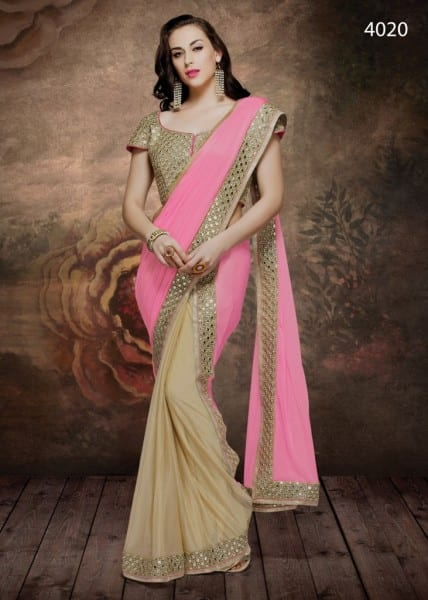 Emit infinite grace and poise in this yellow and pink ready to wear saree with pre-pleated skirt and pallu. The splendid mirror-work embroidered border and blouse is bound to make you look all the more enchanting.